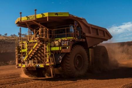 Cat autonomous mining trucks hits haulage milestone